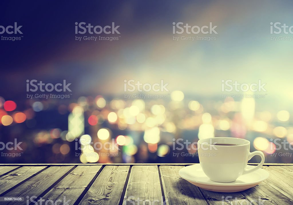 coffee on table in the night city stock photo