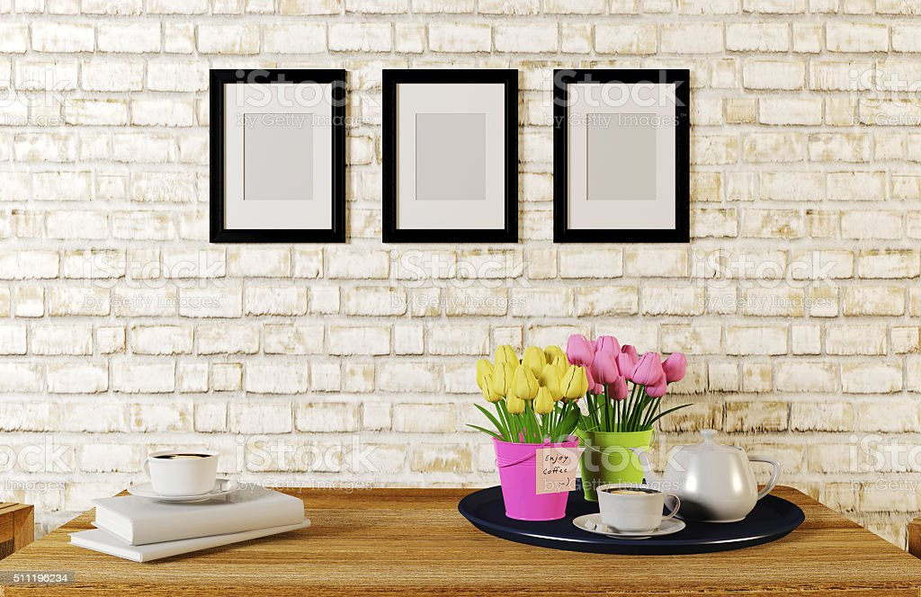 Coffee on table in white room decorated with frames stock photo