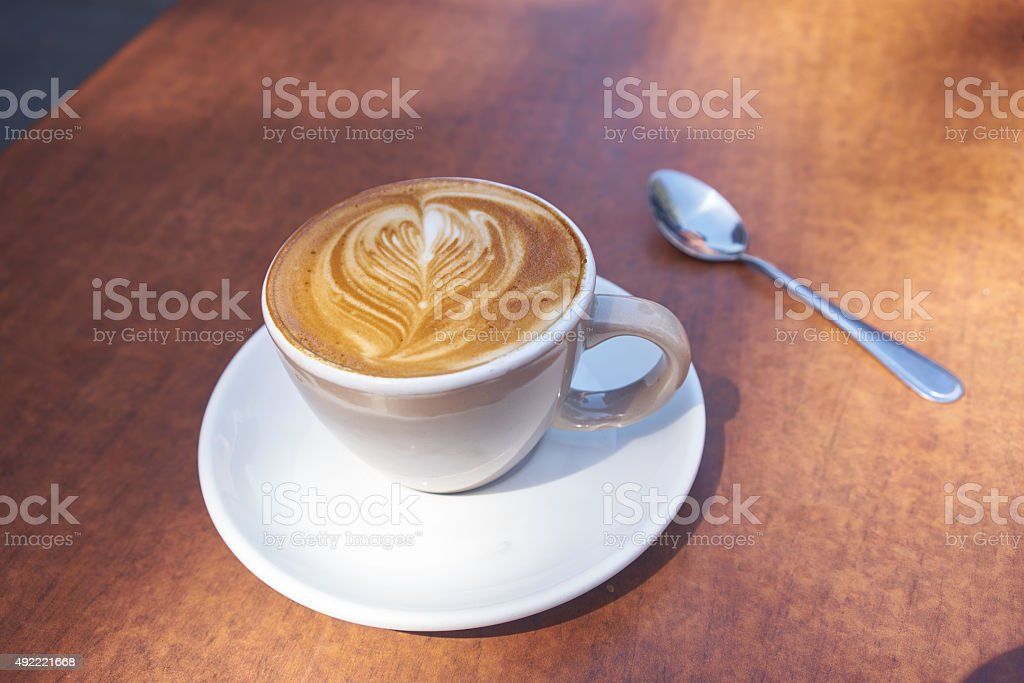 coffee on wooden table stock photo