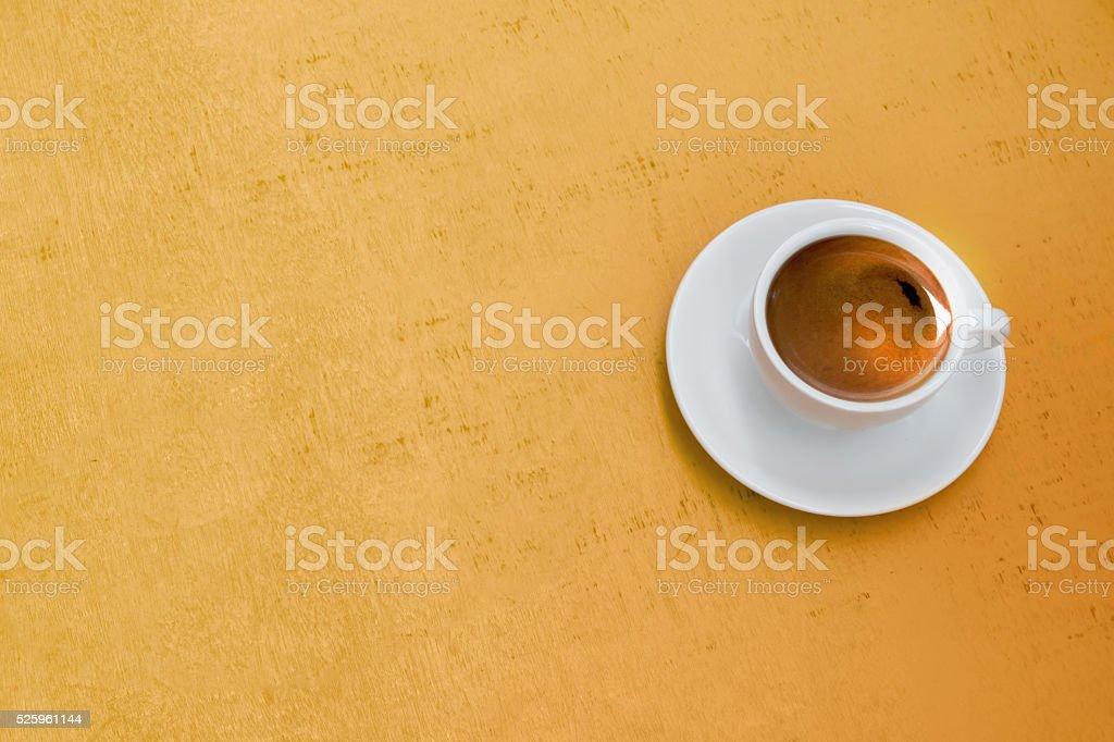 Coffee on yellow background stock photo