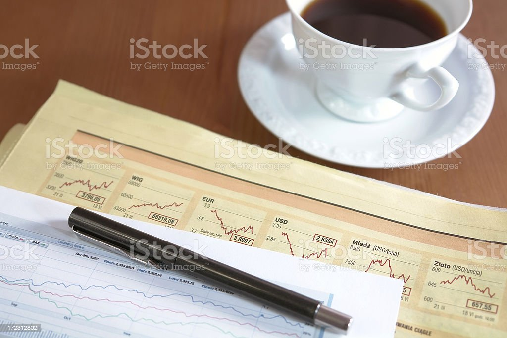 Coffee, pen, newspaper and graphs royalty-free stock photo