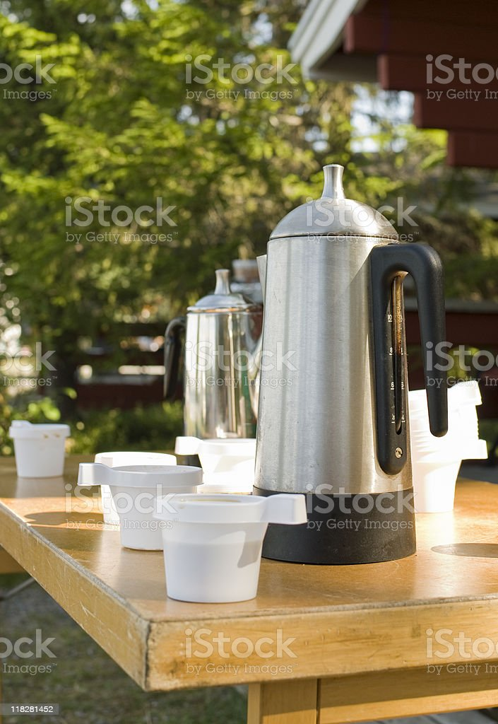 Coffee Perculators and Plastic Cups on Table at Camping Site royalty-free stock photo