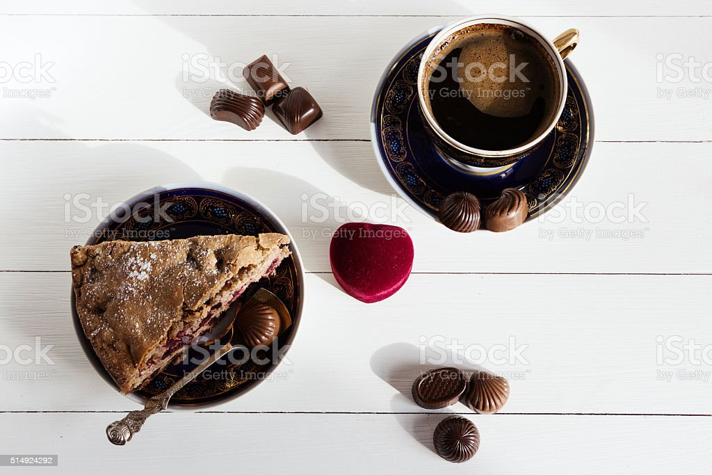 Coffee, pie and box with ring on white background stock photo