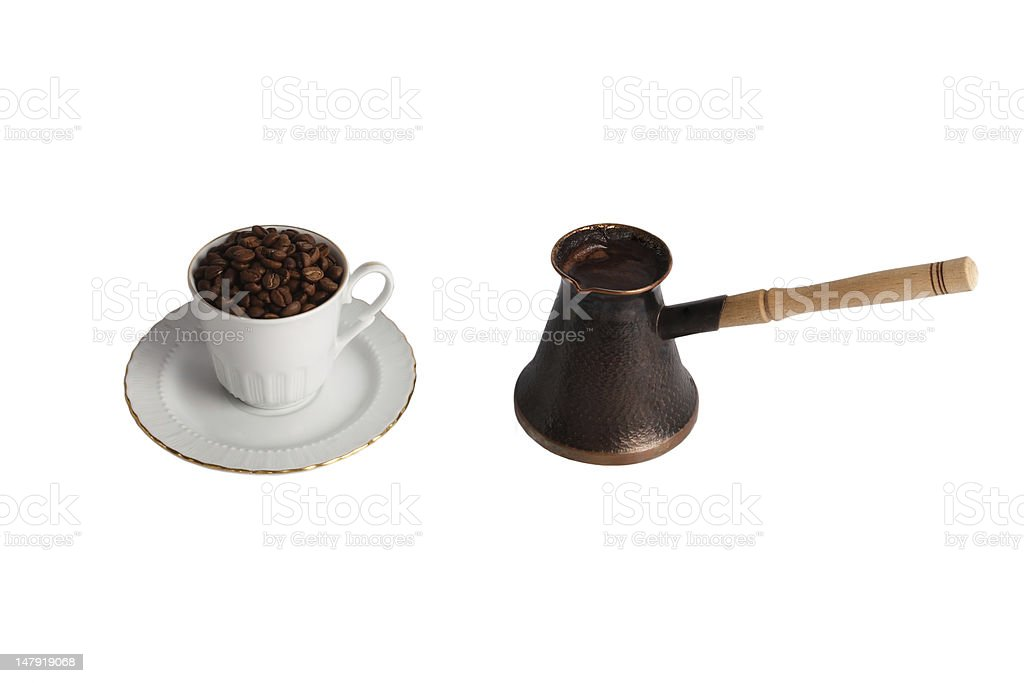 Coffee pot and cup with coffe beans royalty-free stock photo