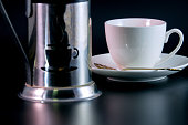 Coffee pot, cup of coffee