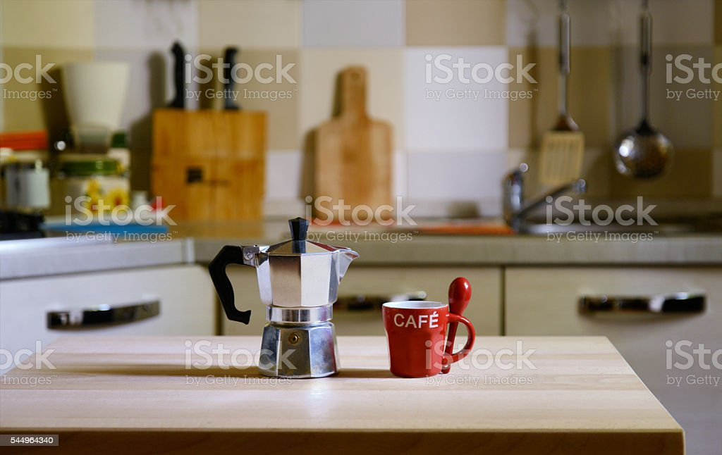 coffee pot on wooden table on kitchen  background stock photo
