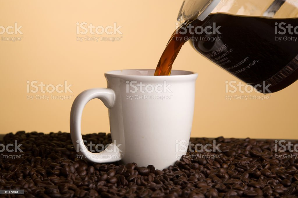 Coffee Pouring into a Cup stock photo