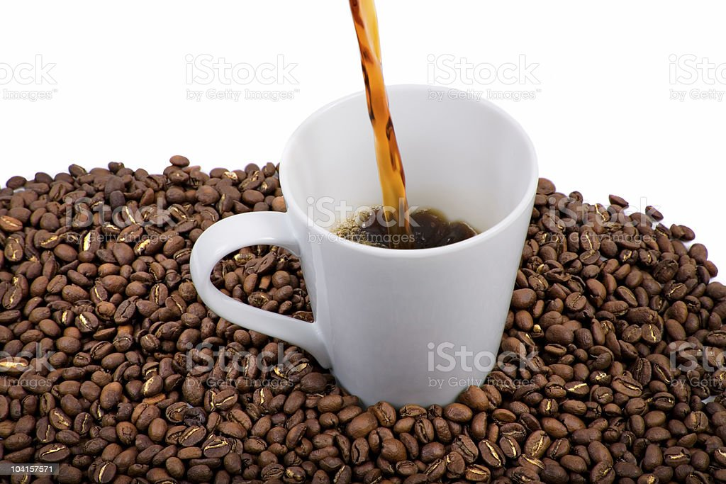 Coffee Pouring Into Cup royalty-free stock photo