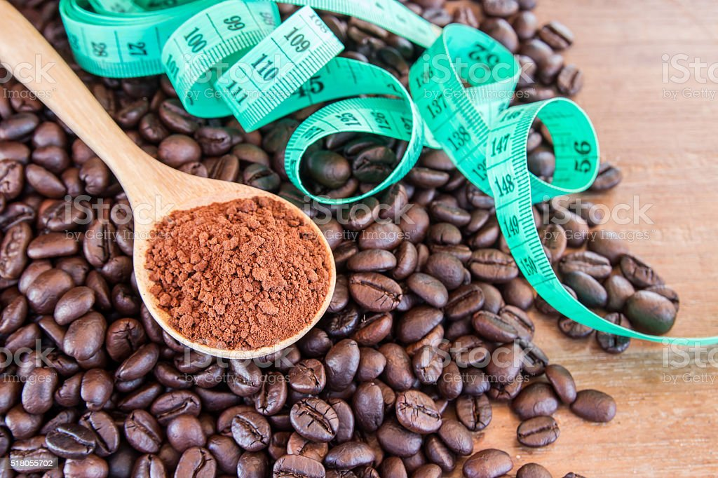 coffee powder in wooden spoon stock photo