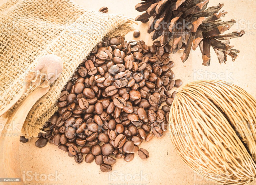 Coffee roasted bean on wooden table vintage style stock photo