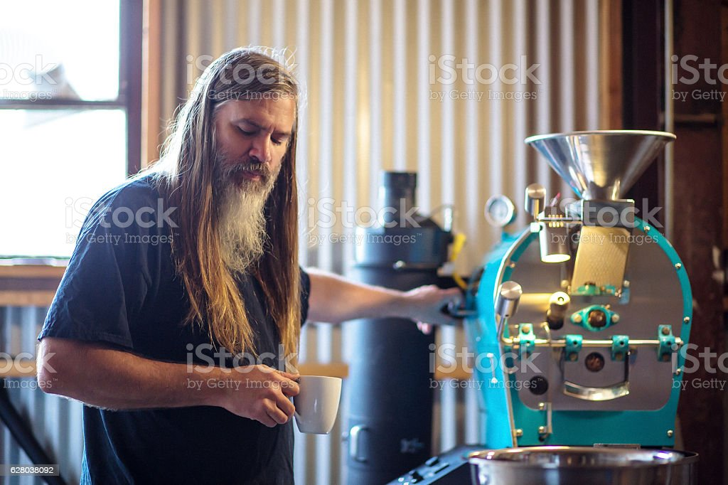 Coffee Roaster Daydreaming at Work stock photo