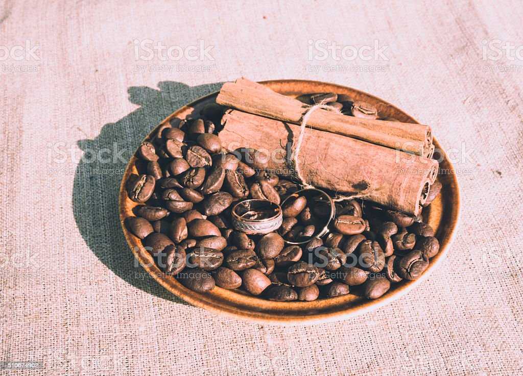 Coffee romantic wedding. Coffee beans and cinnamon sticks stock photo