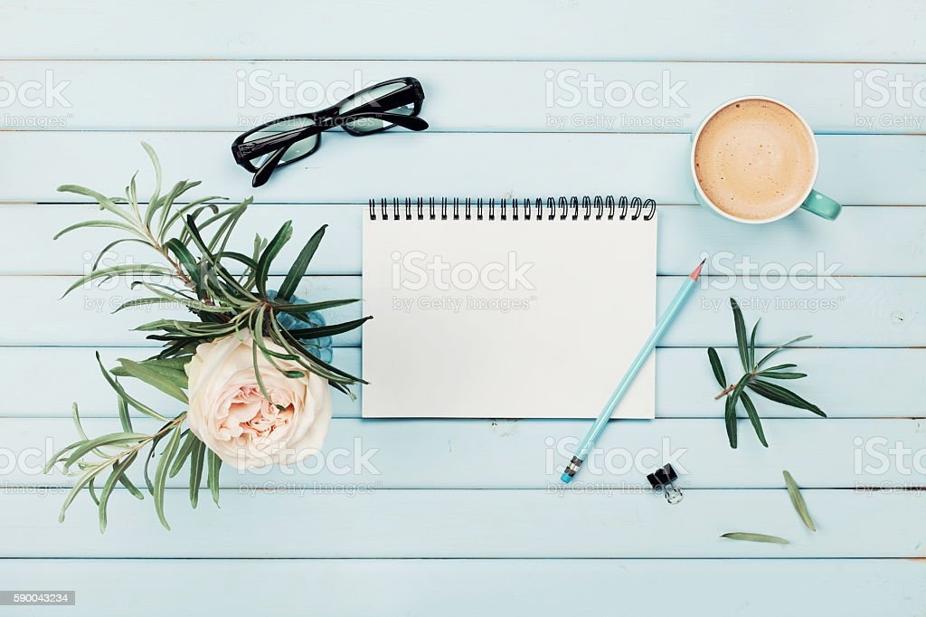 Coffee, rose flower, notebook.  Planning and design concept. Flat lay. stock photo