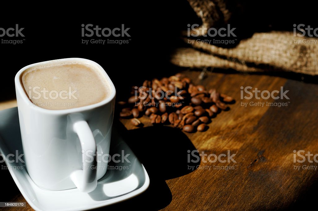 coffee scene, cup, roasted beans, Hessian sack royalty-free stock photo