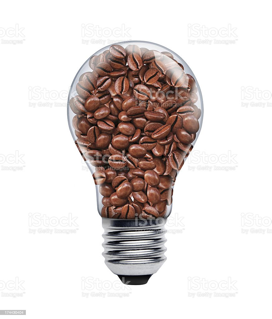 Coffee seeds in a light bulb stock photo