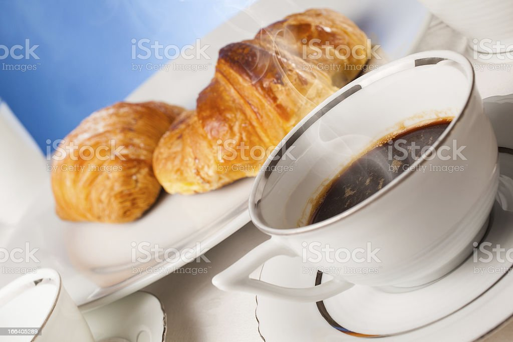 Coffee serrved with croissant and sfogliatella(typical Napoli sweets) royalty-free stock photo