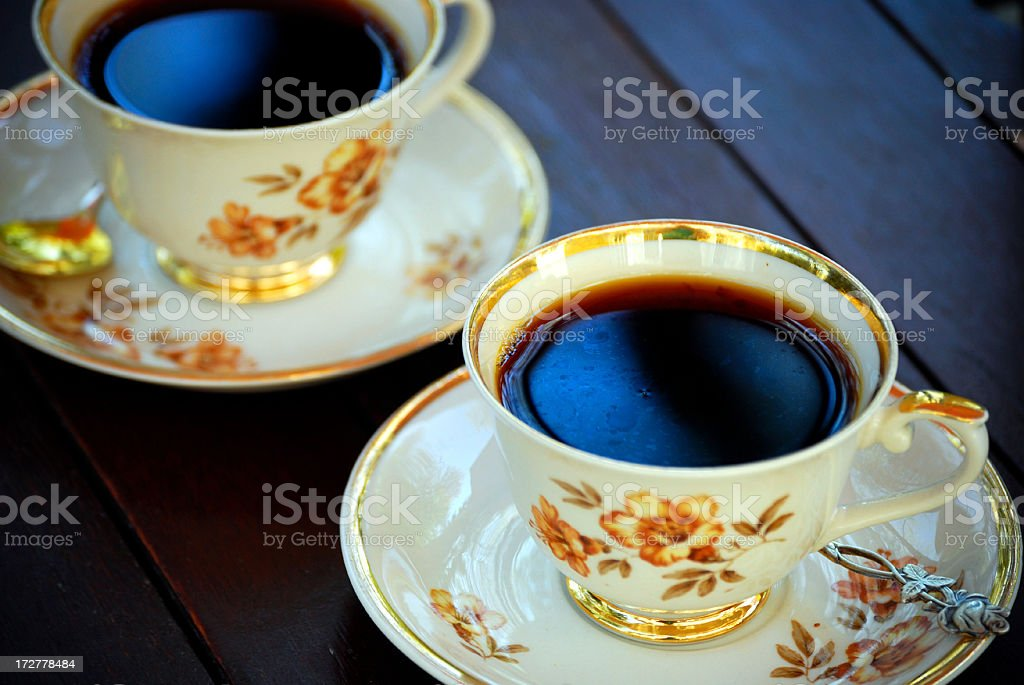 Coffee served from antique cups stock photo