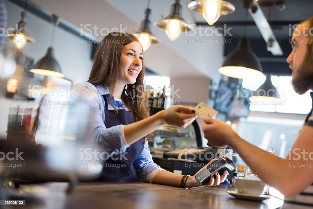 coffee shop credit card payment stock photo