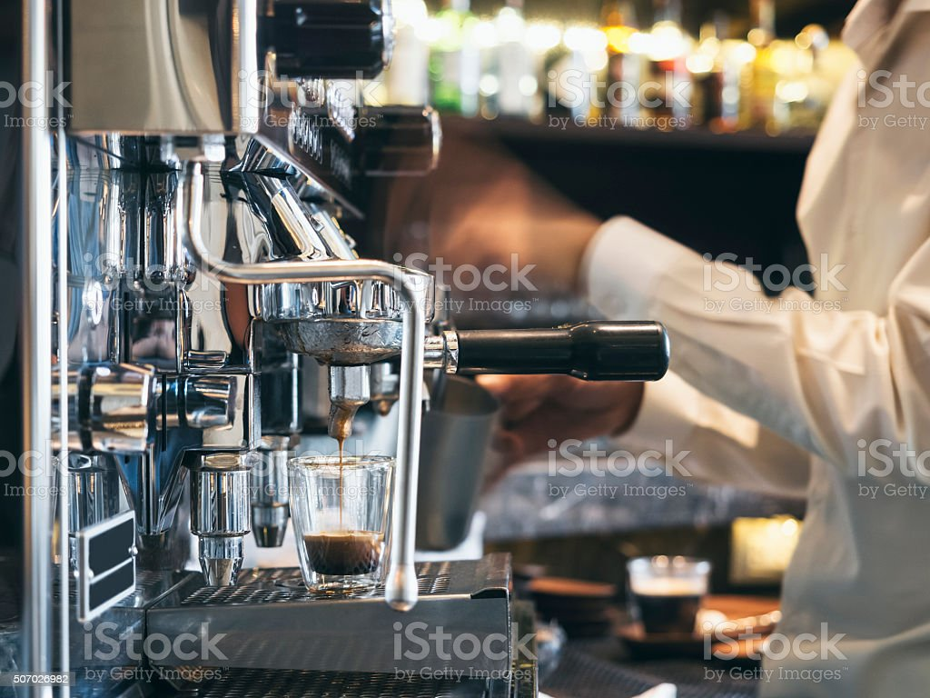 Coffee shop with Barista in Restaurant cafe stock photo