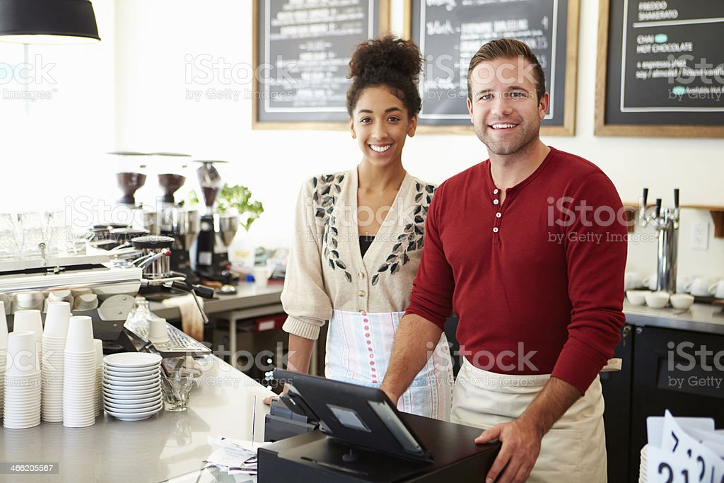 Coffee shop workers smile for photo stock photo