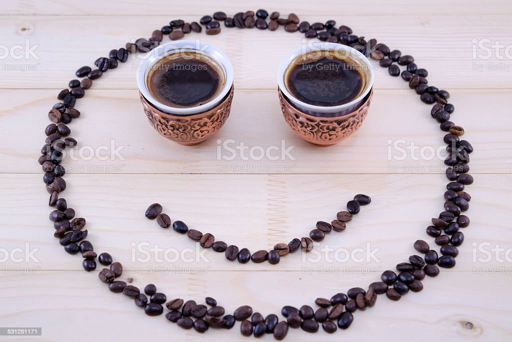 Coffee smiley on a table royalty-free stock photo