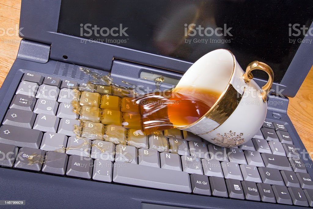 coffee spilling on keyboard stock photo