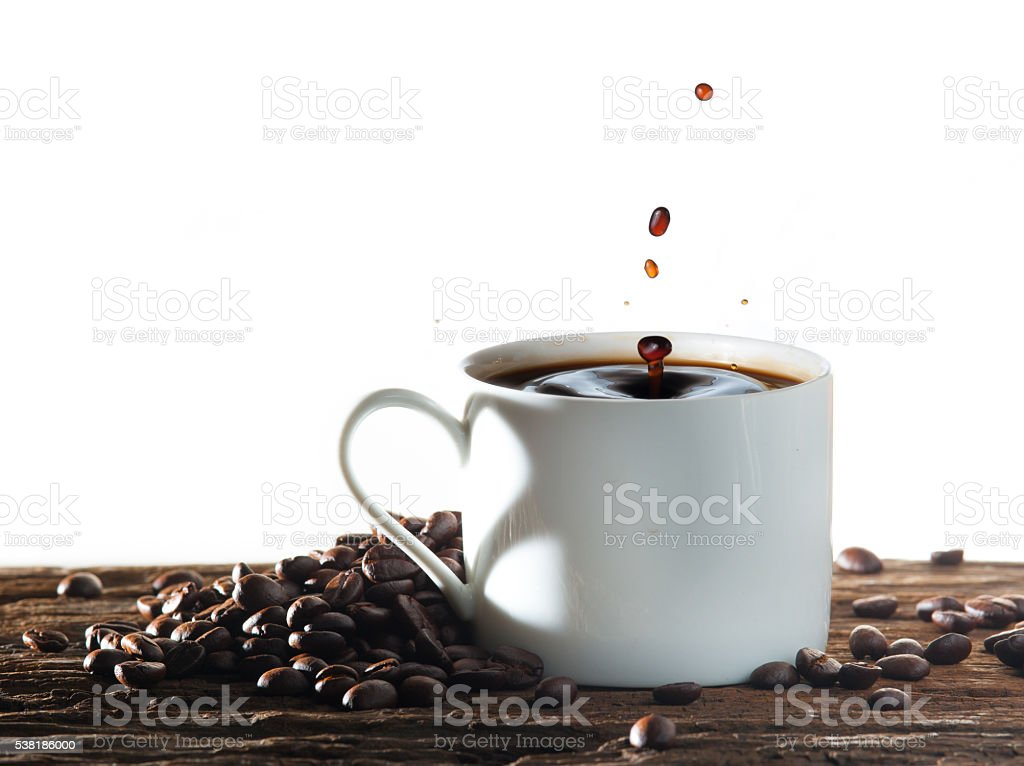 Coffee splash with heart shaped handle shadow stock photo