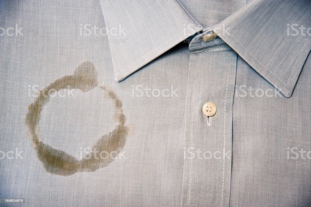 Coffee Stain On A Clean And Folded Shirt royalty-free stock photo