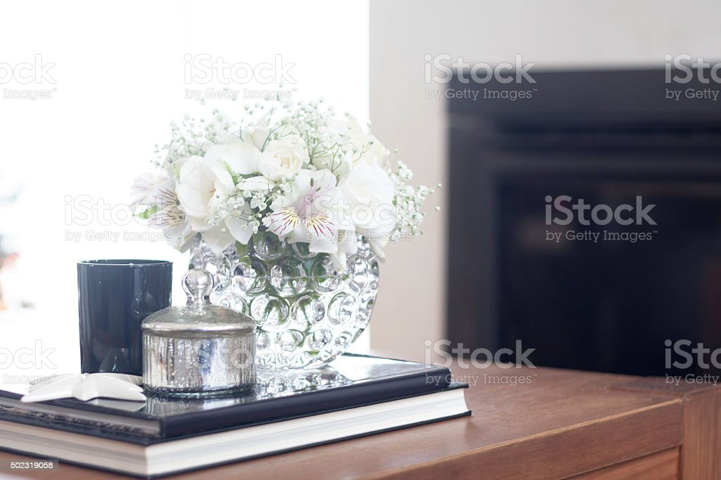 Coffee table living room decoration with white flowers stock photo