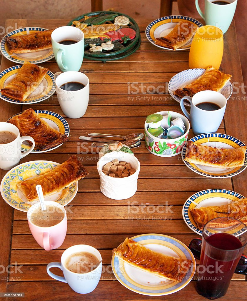 Coffee table with French apple pie stock photo