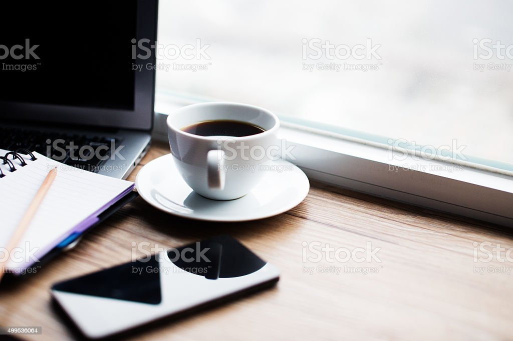 coffee table with laptop smart phone and notebook stock photo