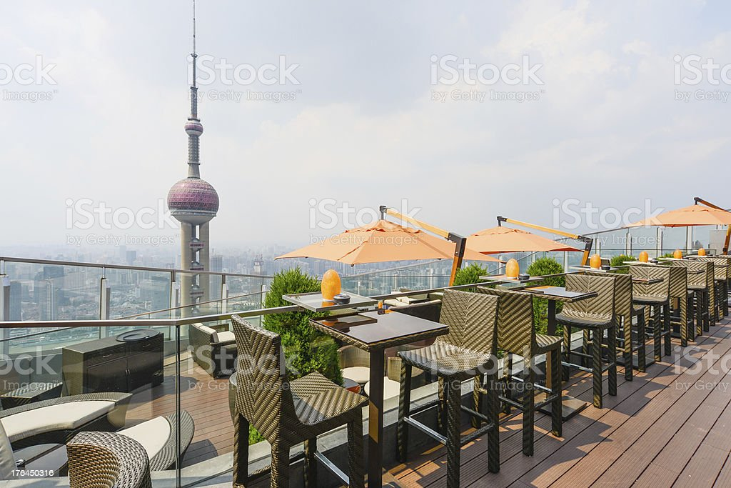 Coffee tables with umbrellas royalty-free stock photo