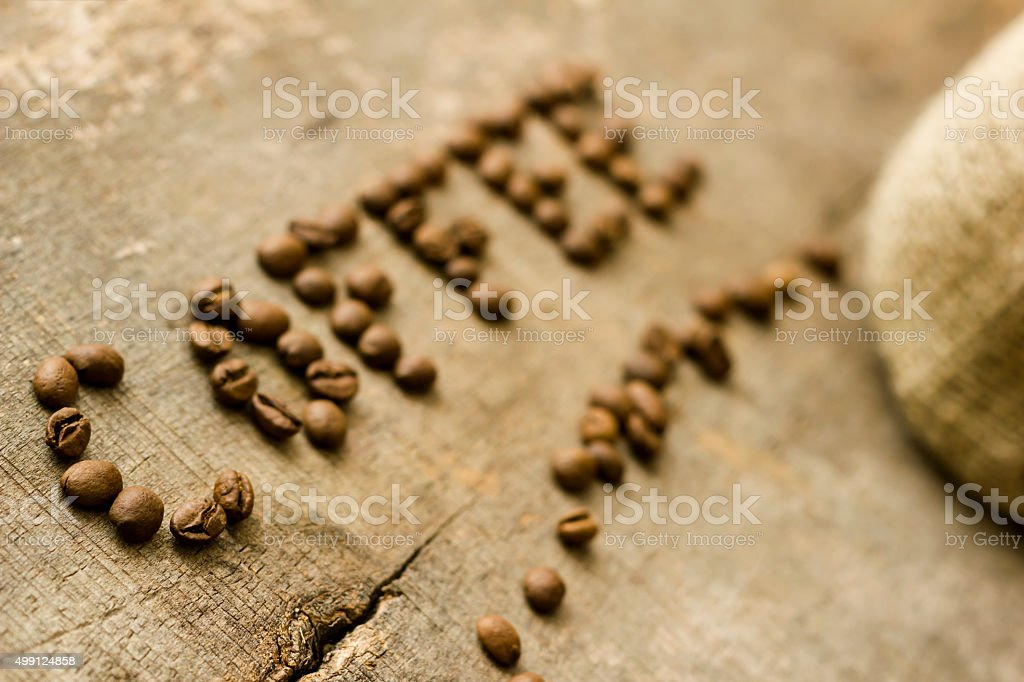 Coffee text made of seeds on old wooden plank stock photo