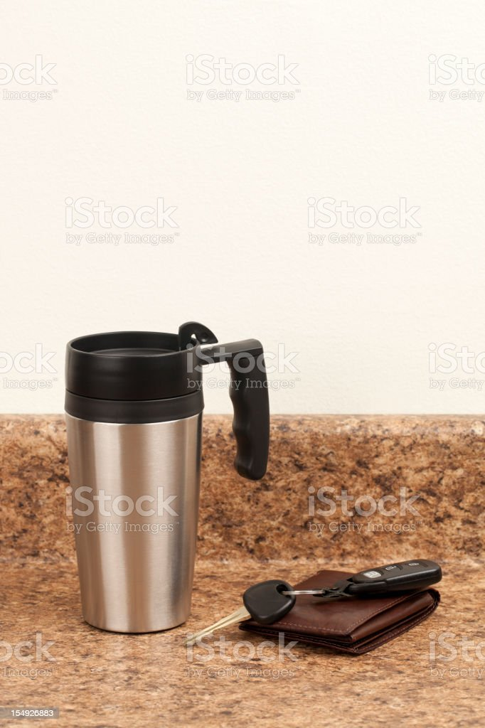 Coffee Thermos, Wallet, and Keys stock photo
