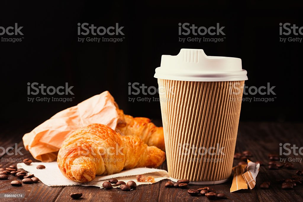 Coffee to go with croissants stock photo