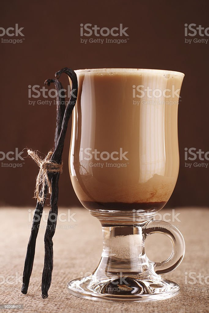 Coffee Vanilla Latte with two tied beans on hessian background royalty-free stock photo