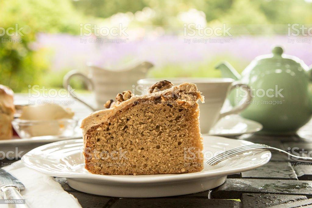Coffee Walnut Cake with Green Tea Pot stock photo