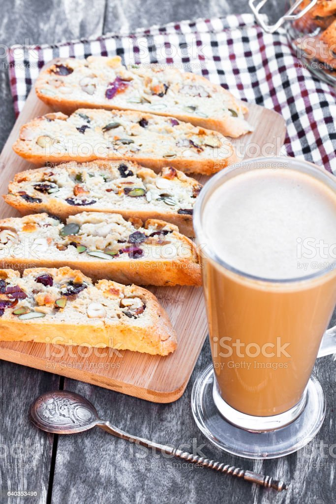 Coffee  with biscotti on wooden vintage table stock photo