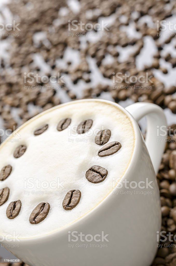 Coffee with blurred beans royalty-free stock photo
