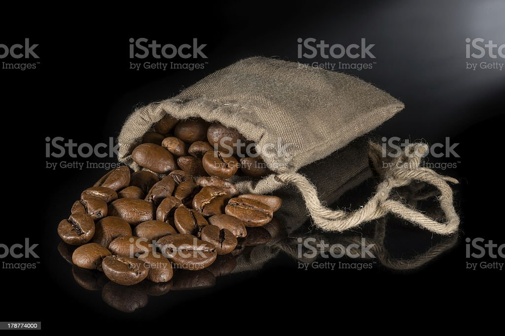Coffee with burlap sack of roasted beans royalty-free stock photo