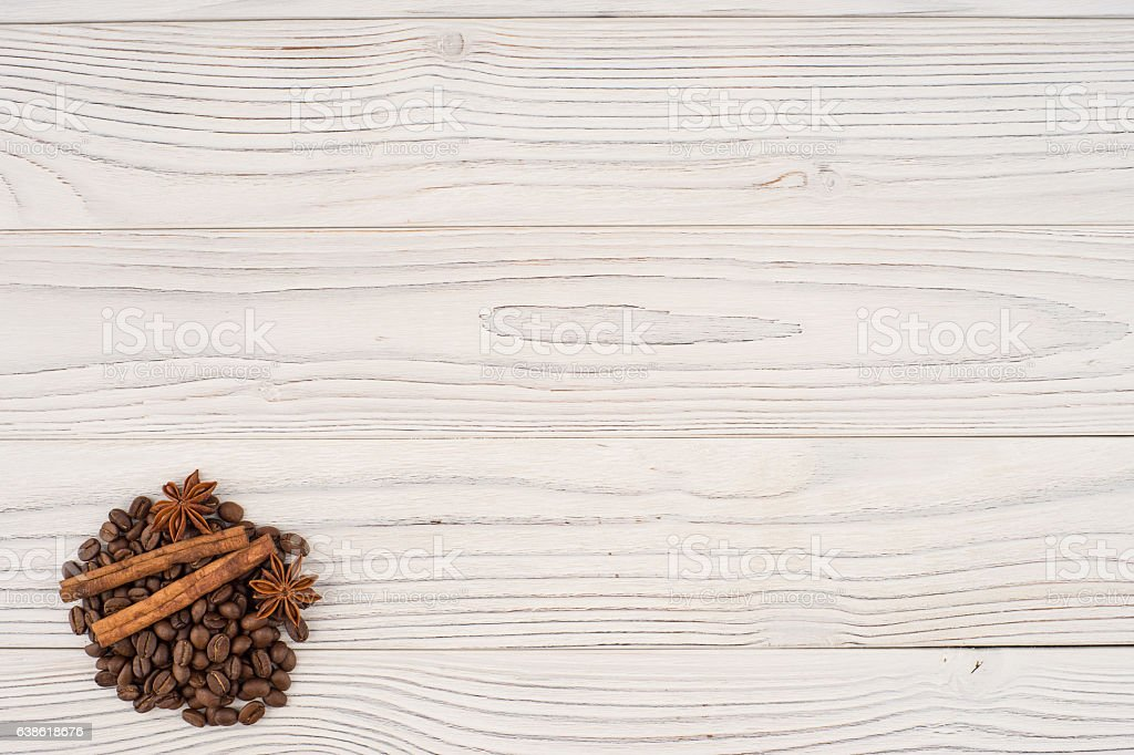 Coffee with cinnamon on old wooden table. stock photo