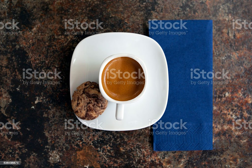 coffee with cookie on a rusted cafe table. stock photo