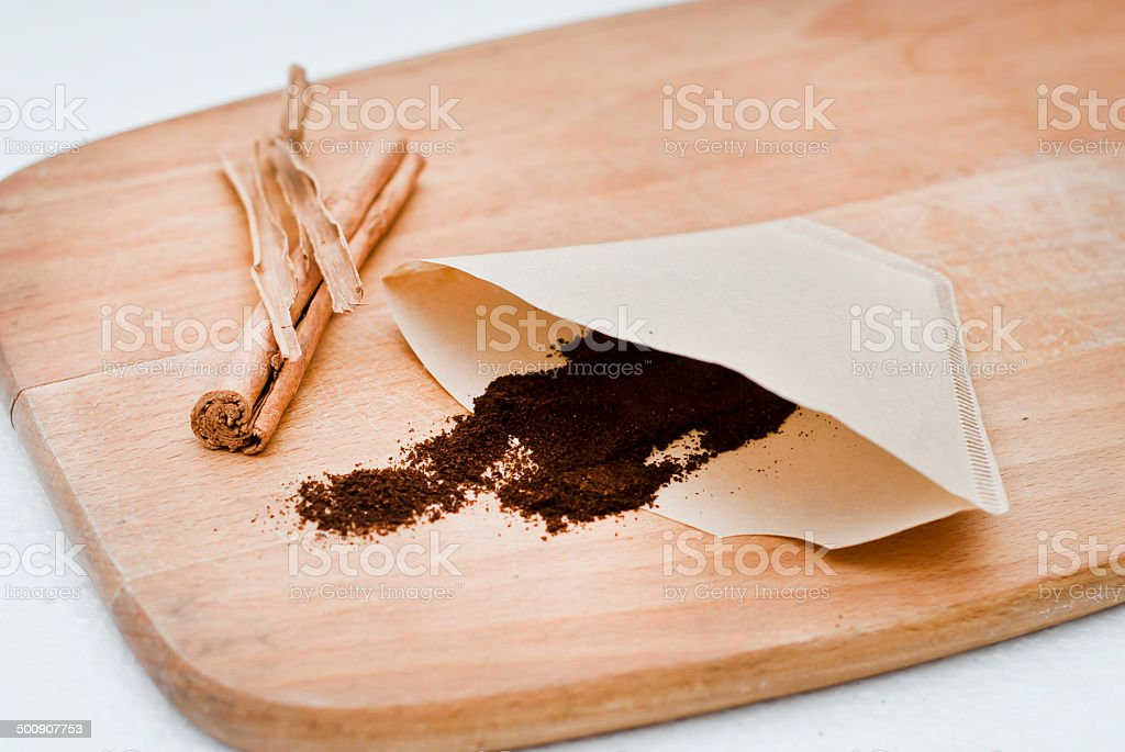 coffee with filter paper and cinnamon stock photo