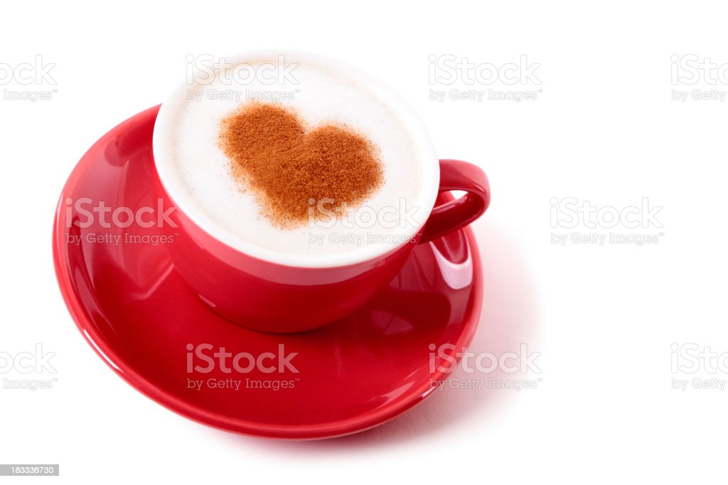 Coffee with heart shaped powder design served in a red cup royalty-free stock photo