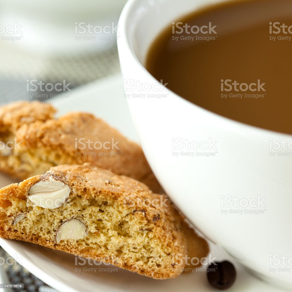 Coffee with milk and cantuccini royalty-free stock photo