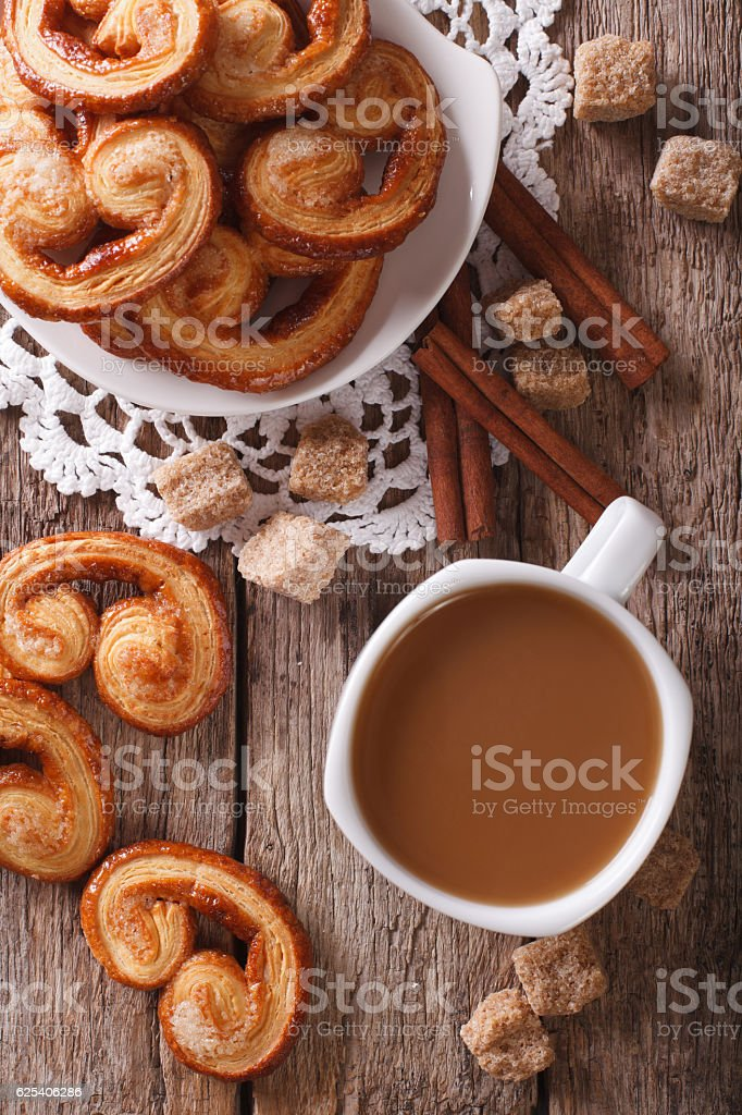 Coffee with milk and cookies Palmiers on the table. vertical stock photo