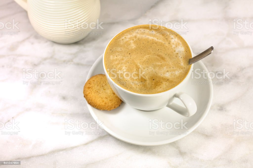 Coffee with milk, butter cookie and milk jar stock photo