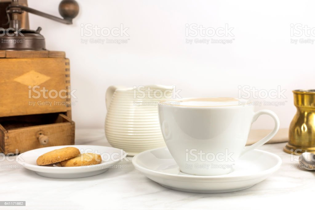 Coffee with milk, butter cookie, milk jar and copyspace stock photo