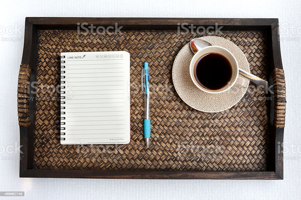 Coffee with note book on the tray royalty-free stock photo
