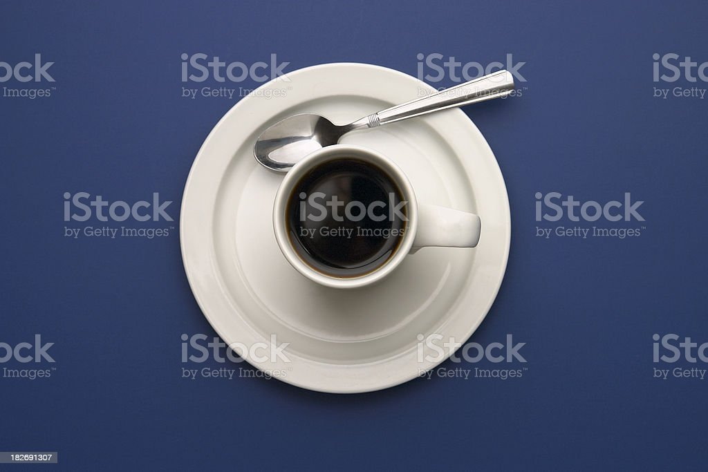 Coffee with Spoon on Blue stock photo